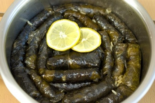 Grape leaves stuffed with meat and rice, or stuffed with rice and vegetables (vegan). Two per serving.